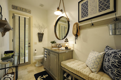 comfortable powder room with seatings and its accent throws, filled with unique decorations