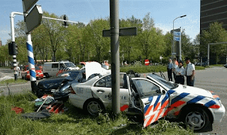 Funniest pictures of police: Dutch police car collided against pole