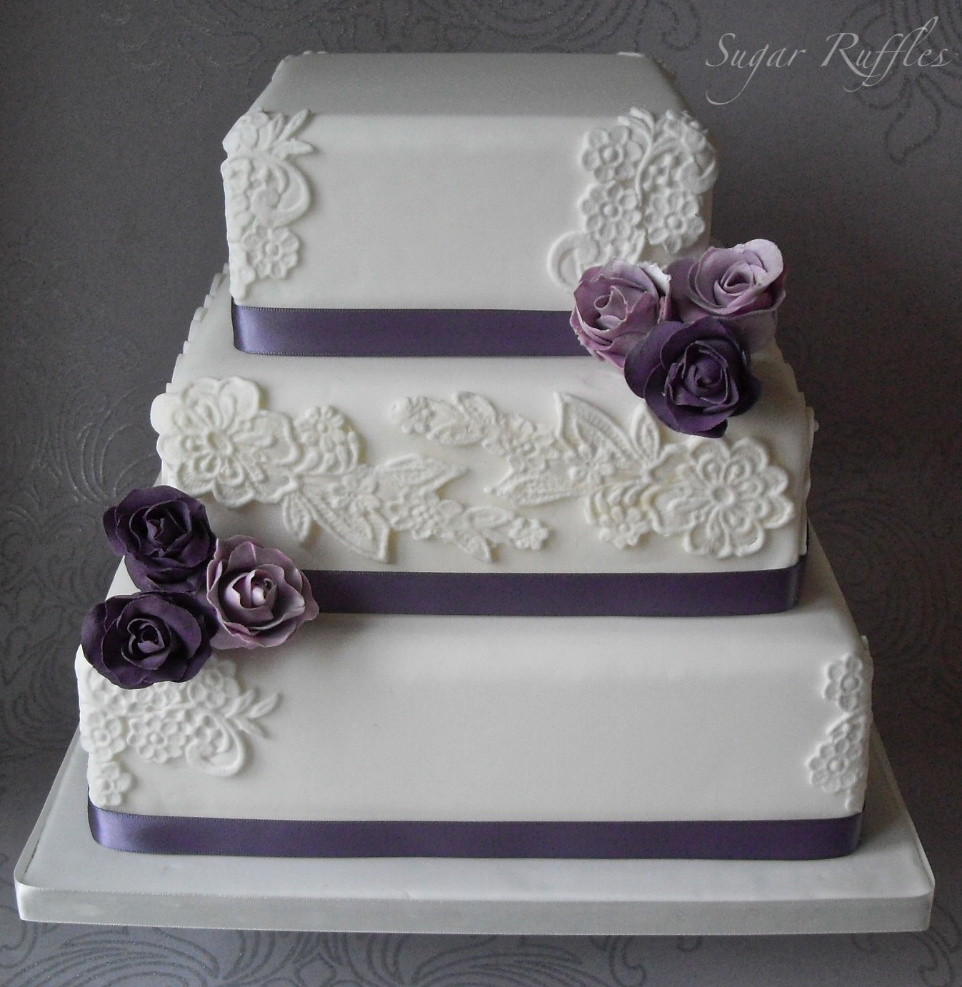 Lace Wedding Cake With Purple Roses