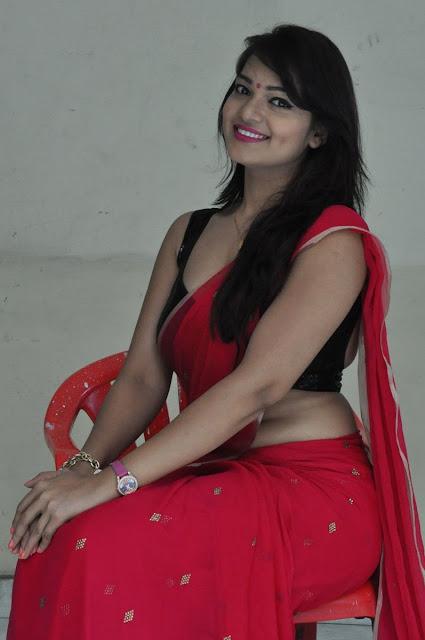 Cute Ashwini Photos In Red Saree