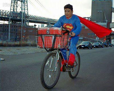Modern Superman riding a Bi-cycle - Funny Images Online