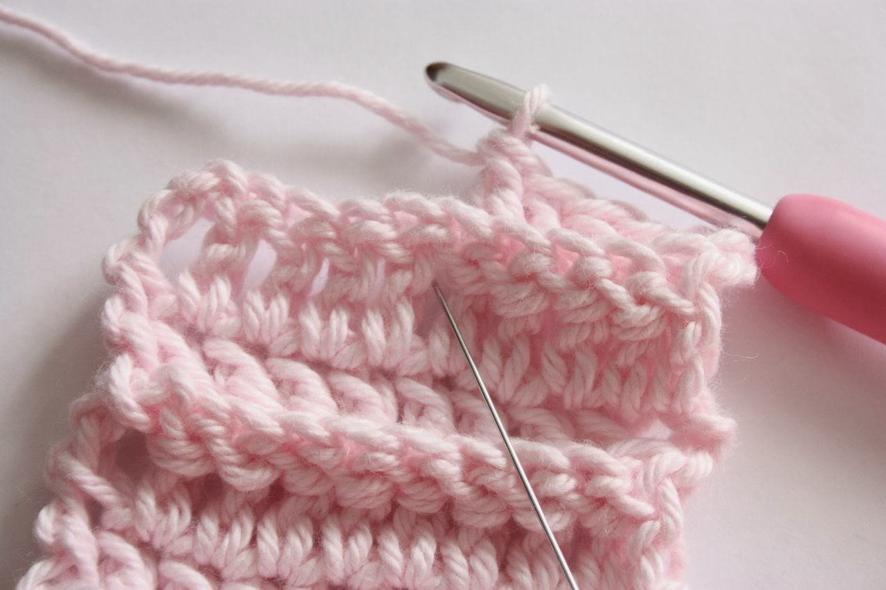 back of the crochet, between the stitches to the right of the stitch ...