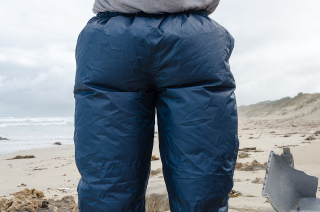 waterproof overpants puffed up by wind