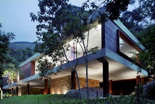 Modern design glass house in the mountain region home decorating