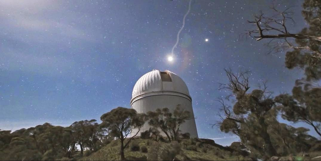 An artist's impression of light from a distant star entering the Anglo-Australian telescope at Siding Spring Observatory to be analysed for the GALAH survey. Credit: Amanda Bauer, AAO.