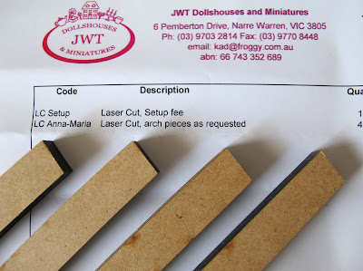 Four laser-cut wooden beams laid out on the invoice.