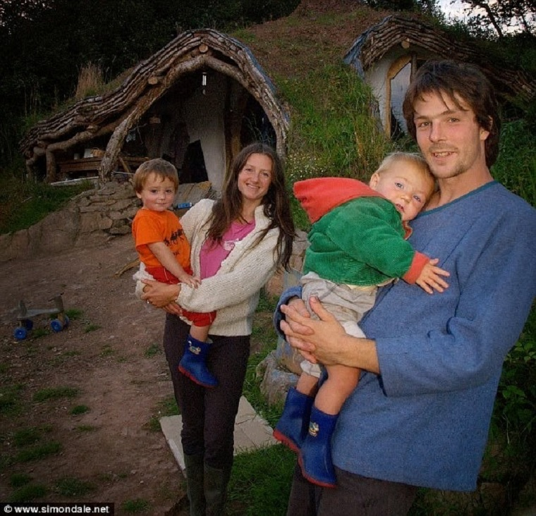 Man Builds Fairy Tale Home for His Family – Total Cost £3,000 - Simon Dale, his wife Jasmine Saville, and their two children.