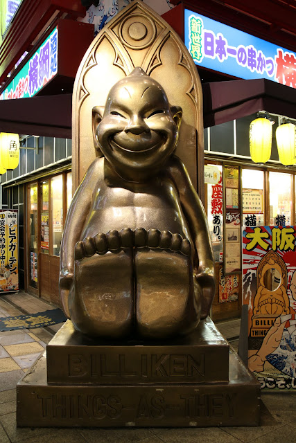 Biliken is a deity statue to bring good luck if you rub the soles of his feet at Tsutenkaku Tower in Osaka Shinsekai in Japan