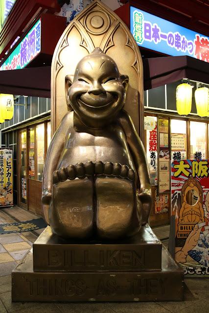 Biliken is a deity statue to bring good luck if you rub the soles of his feet at Tsutenkaku Tower in Osaka Shinsekai in Japan