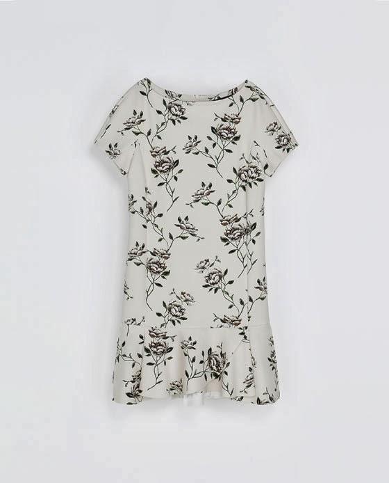 http://www.zara.com/es/es/mujer/vestidos/vestido-neopreno-volantes-c552017p1451524.html
