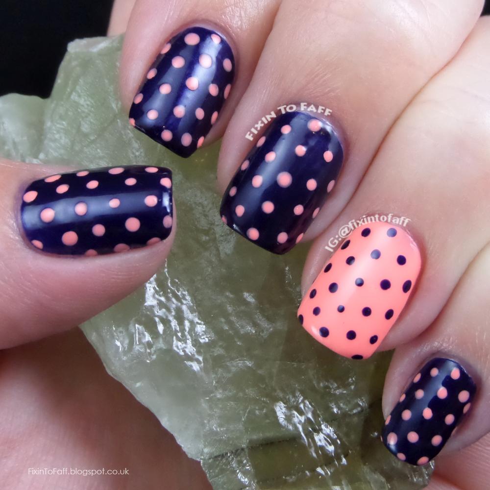 Pastel coral and dark navy blue polka dot nail art, recreation of a look from BeHappyAndBuyPolish.