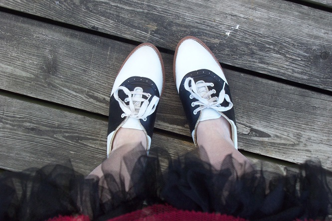 vintage black and white saddle shoes, black crinoline skirt, 1950s shoes, 50s casual lace up shoes, feet posing on wooden deck, retro style, vintage fashion, Vintage Witch Shoppe