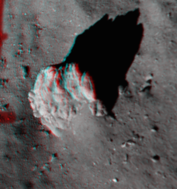 This image, created from Philae's ROLIS descent camera, focuses on the largest boulder seen in the image captured at 67.4 m above Comet 67P/Churyumov–Gerasimenko. It is best viewed with red/blue–green glasses. The 3D view highlights the fractures in the 5 m-high boulder, along with the tapered 'tail' of debris and excavated 'moat' around it.  This 'tail' feature has also been identified around boulders elsewhere on the comet in OSIRIS images taken from orbit. The ROLIS team thinks the tails appear as a result of the region 'behind' an obstacle being shielded from erosion via the impact of falling particles arriving in a prevailing direction, perhaps from activity elsewhere on the comet. Credit: ESA/Rosetta/Philae/ROLIS/DLR