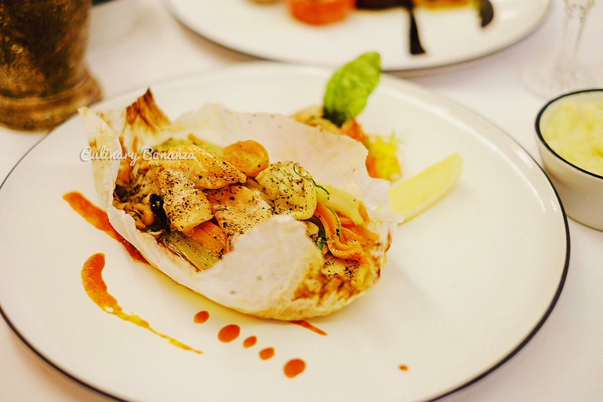 Papilote of The Sea - mixed seafood & vegetables with green butter, baked in pastry paper (www.culinarybonanza.com)
