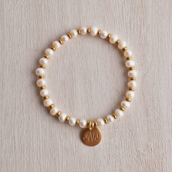 http://www.whitetrufflestudio.com/collections/bracelets/products/white-truffle-monogram-pearl-bracelet