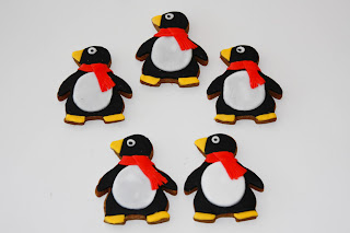 5 penguin biscuits with red scarves