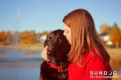 Jenny kisses her dog, Mason