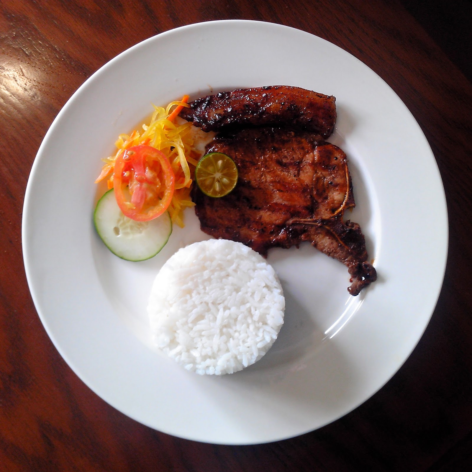 Loving the smoky flavore of their Grilled Porkchop for Php99.00 only