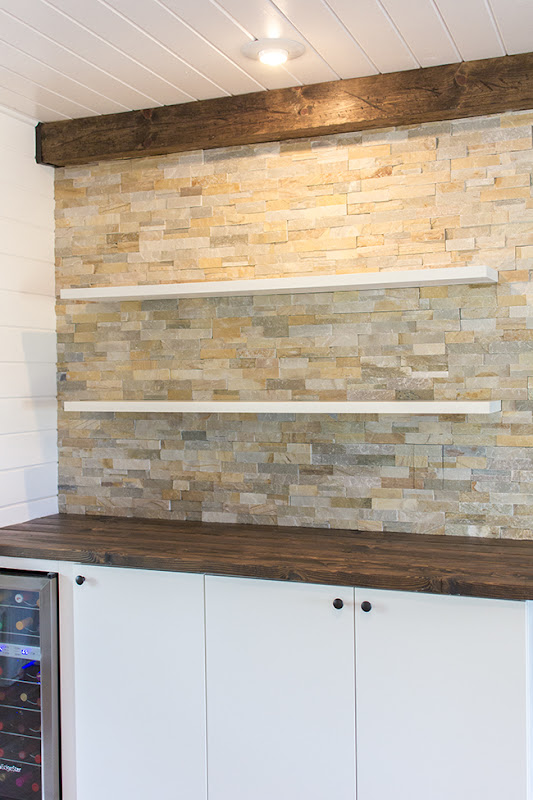 Stacked Stone Kitchen with Floating Shelves