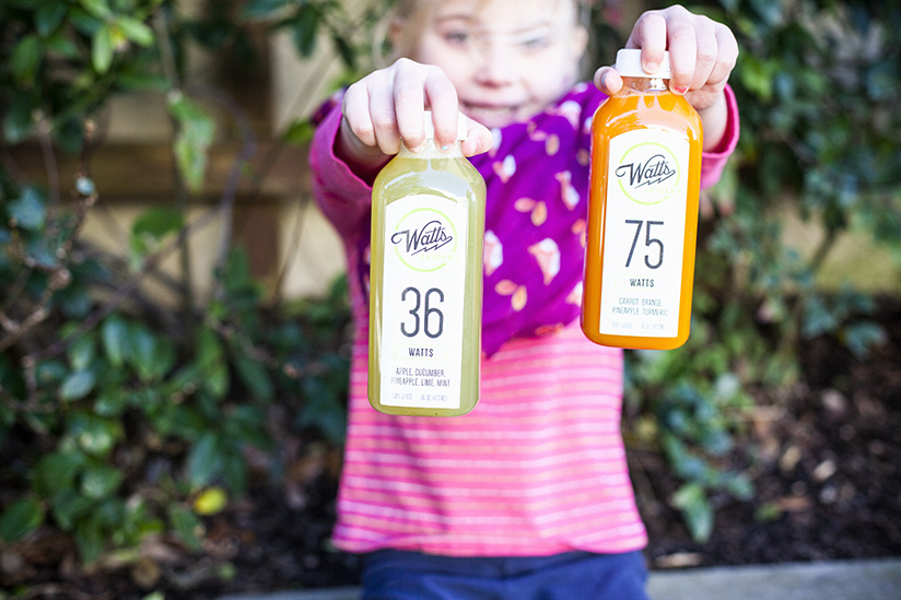 little girl holding juice from Watts Juicery