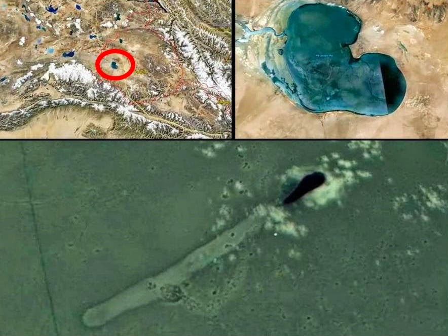 UFOs fly out of a black hole in Lake Aksayqin Hu near Kongka La Pass - recorded by Google Earth
