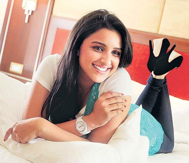 On Bed Parineeti Chopra looks very cute in her latest hot photoshoot HD pics