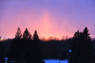 photo of sunset with light pillar