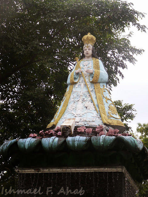 Our Lady of the Airways icon in front of the church
