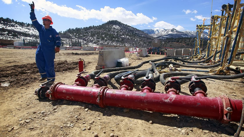 Pumps at an Encana Oil & Gas Inc. hydraulic fracturing and extraction site, outside Rifle, in western Colorado, on March 29, 2013. (Credit: Brennan Linsley/AP Photo) Click to enlarge.