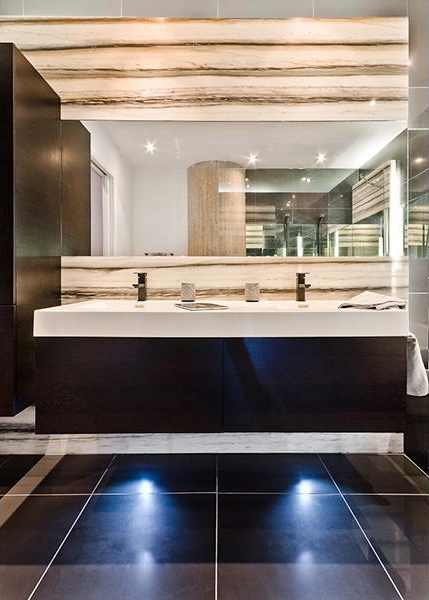 Picture of the sink and mirror in the modern black bath room