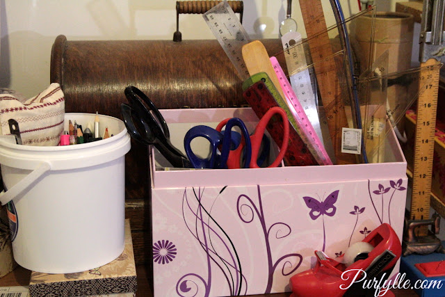 re-purposed card box holding scissors and rulers