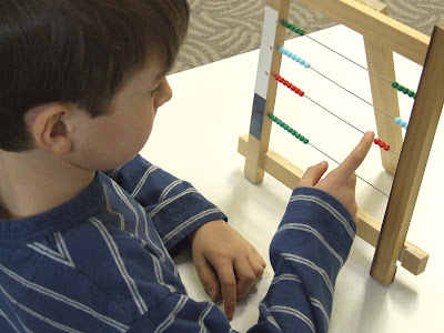 NAMC integrating older new montessori student into montessori classroom