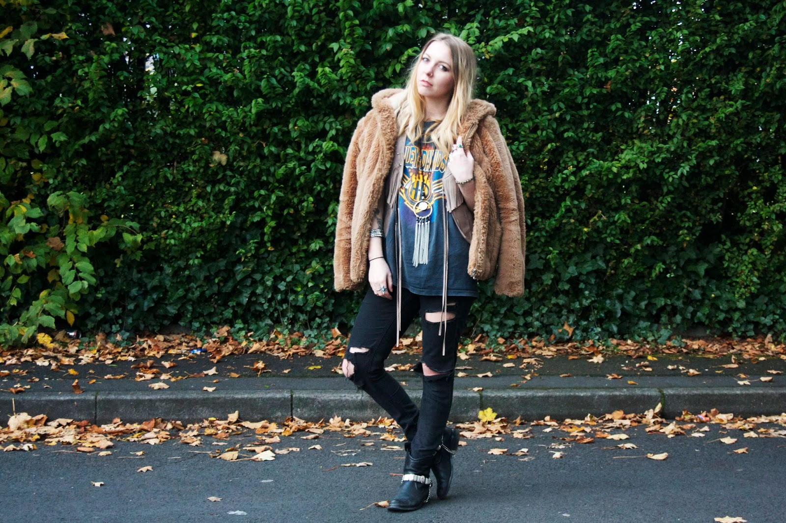 An outfit of the day blog post featuring faux fur, ripped jeans, and harley davidson