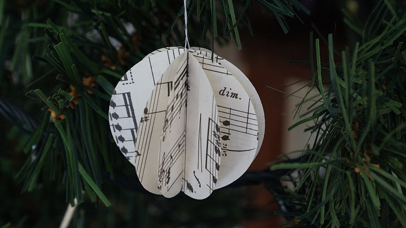 to make these cute garlands you need a large circle hole punch or some scissors a shot glass some old sheet music and a sewing machine - Christmas Decorations To Make With Sewing Machine