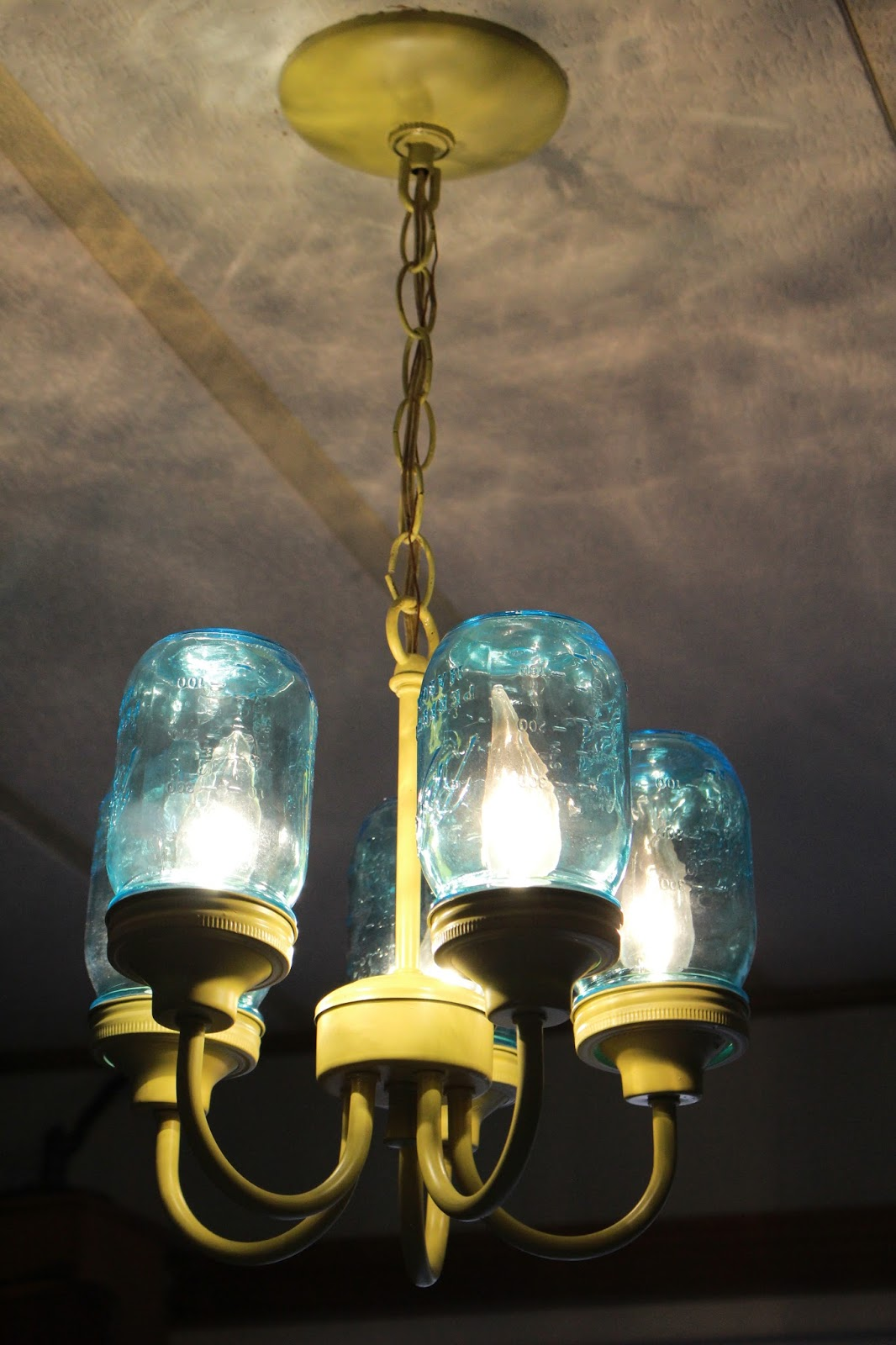 Homestead wannabes up cycled mason jar chandelier fit for a homestead the small mouth lids were the perfect size to grip the chandelier cups from the bottom arubaitofo Choice Image