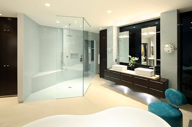 Picture of the modern bathroom with large shower cabin and dark brown furniture