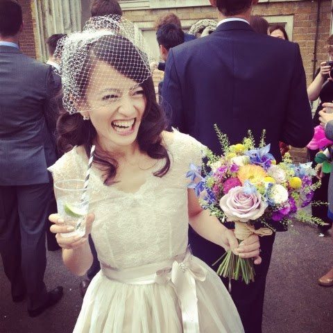 Sophie laughing after her wedding, in Chantilly dress from the Heavenly Collection.
