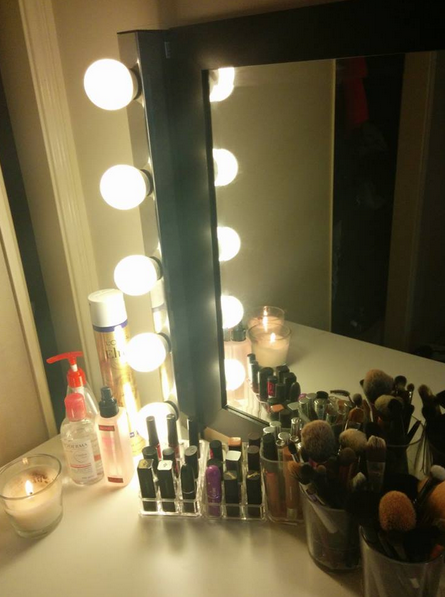 The light fixtures are MUSIK wall lamps, and I got one for each side of the  mirror - $29.99 each at IKEA - The Beauty Break Down: How I Got My Vanity Set Up