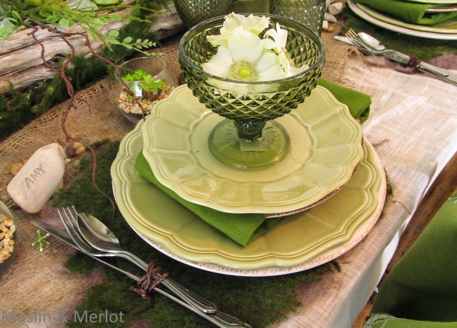 Lovely green place setting. Carved driftwood place cards.