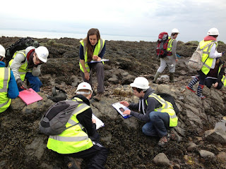 Students explore the rocks of the Fife Coast