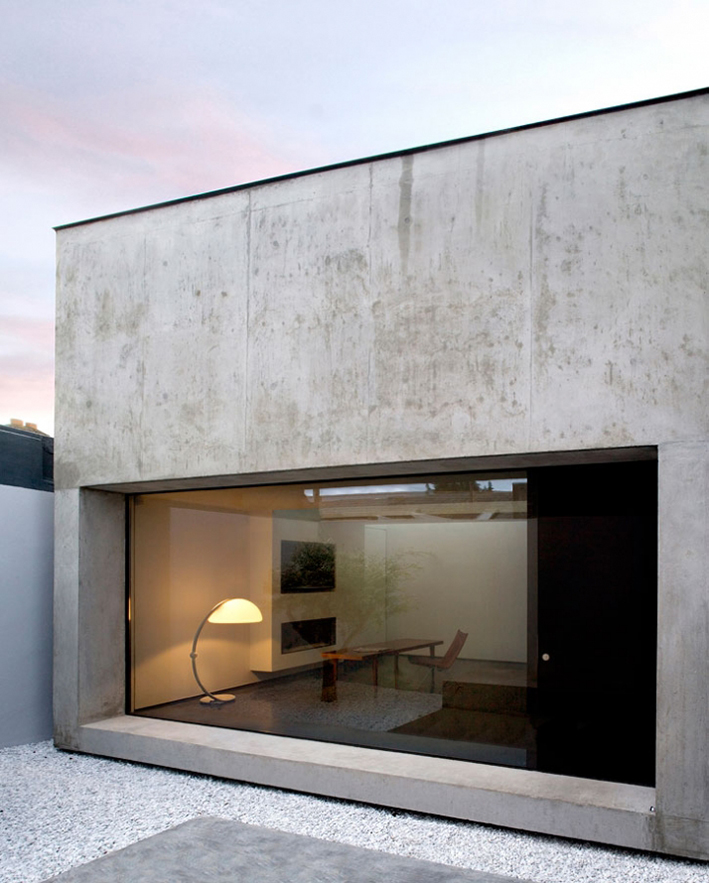 rendered concrete house facade with lard windows