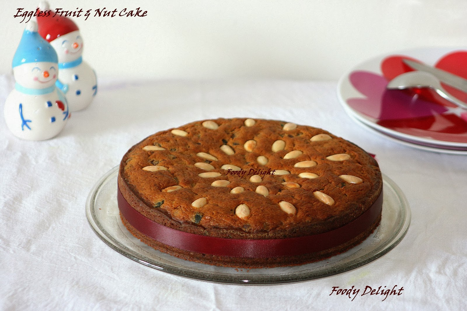 Christmas cake decoration with fruit and nuts - Eggless Fruit And Nut Cake Christmas Cake
