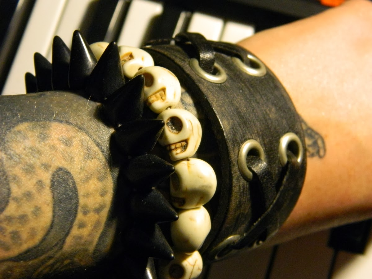 distressed leather wrist cuff, stone skull bead bracelet, black stone spike bead bracelet - Raivyn dK tattoos - Akai MPK49