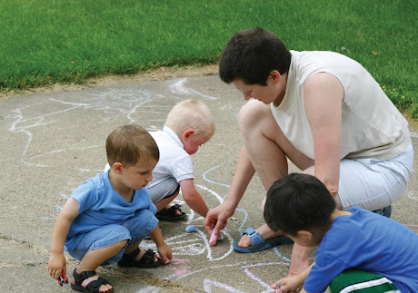 children chalk drawing NAMC montessori first plane of development