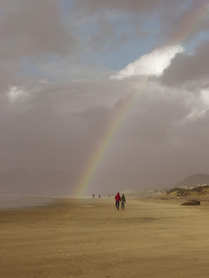 photo of rainbow over Rockaway Beach Oregon by Nancy Zavada