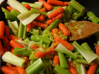 Carrots and Celery Being Stirred with Sauteed Leeks