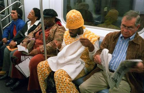 This man is actually crocheting, not knitting, but the important thing is that he is doing it on the subway