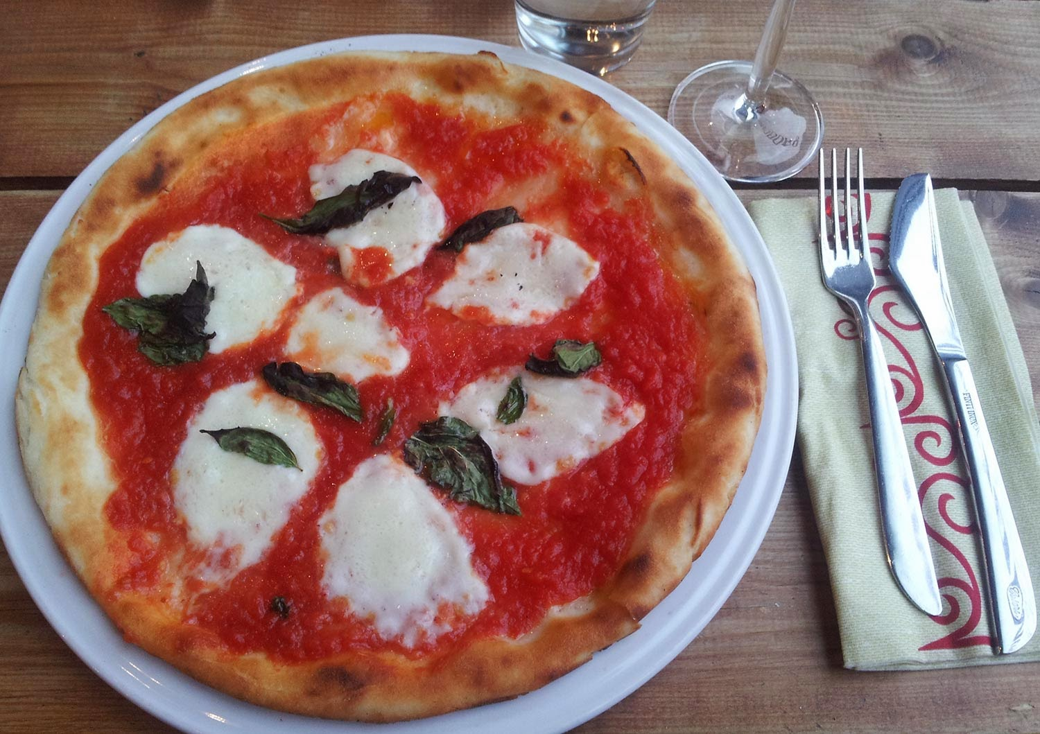 Gluten-free pizza at Rossopomodoro in Wandsworth, Greater London. Mozzarella, tomato, basil...sometimes, simple is best. Pooling saliva: not pictured.  Image © Anita Isalska