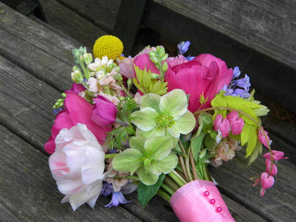 Wedding flowers from springwell spring time wedding flowers in hot pink this is the first year i have used bleeding hearts in a bouquet design and i thought the flower held up very well i would love to have a bride next april izmirmasajfo