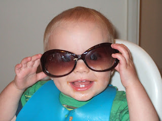 Funny baby with glasses